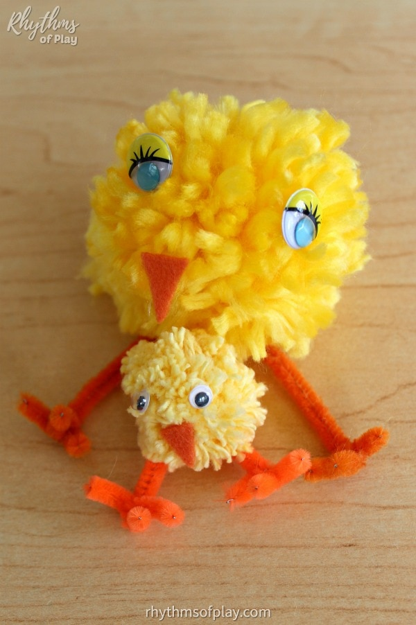 DIY pom-pom baby chick crafts siting on a table