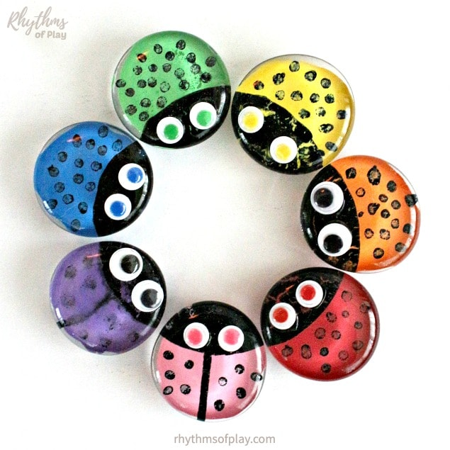 rainbow ladybug glass magnets in a circle on the refridgerator