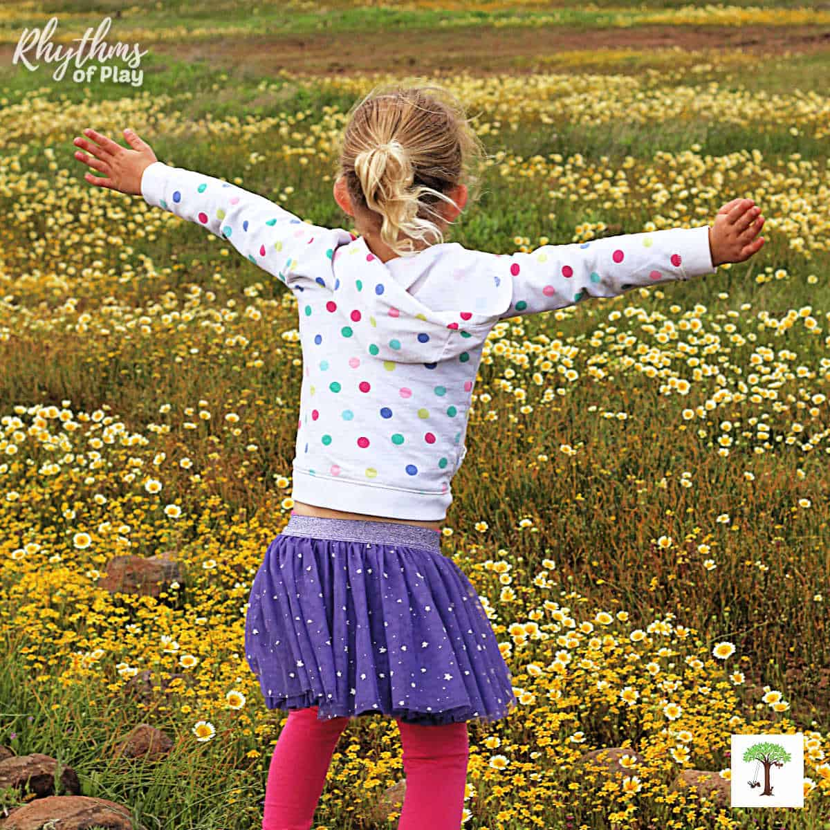 Preschool girl spotting a field of wildflowers on spring scavenger hunt.